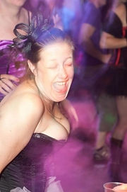 Woman partying at burlesque-themed wedding