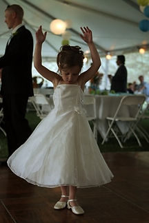 Young bridesmaid dancing at reception