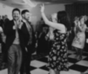 Happy groom & guests at Wedding reception