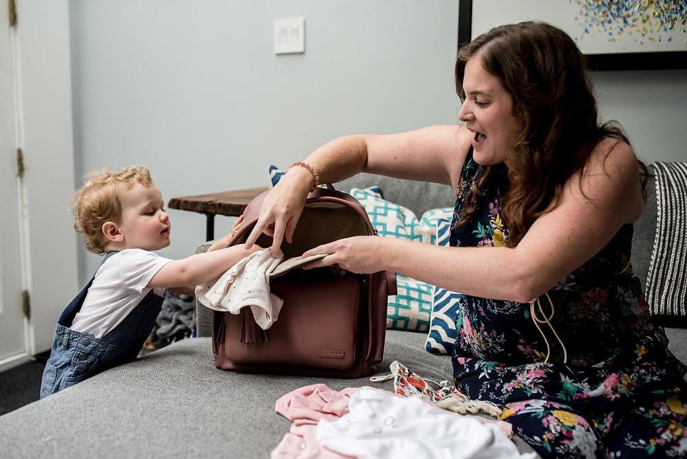 mom packing diaper bag
