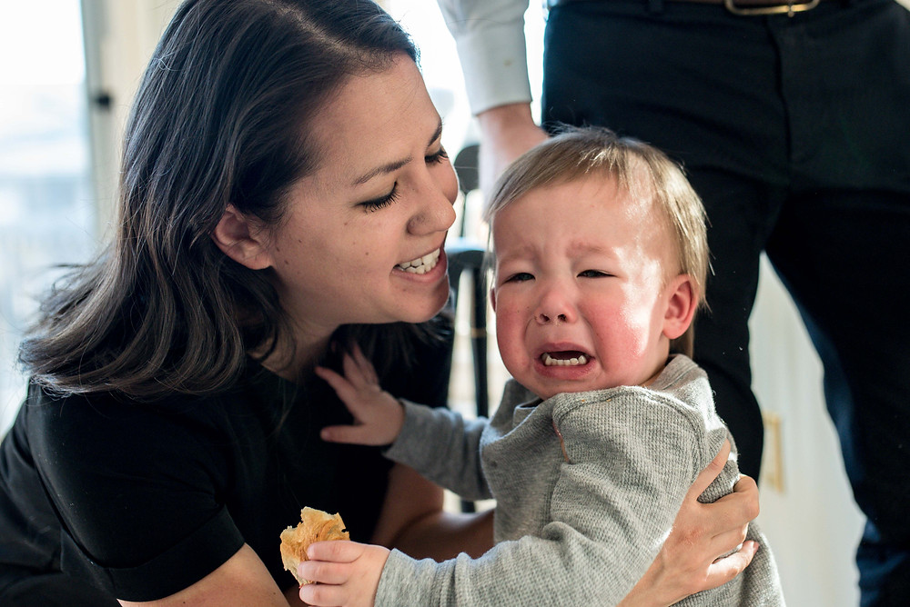 mom soothing crying child