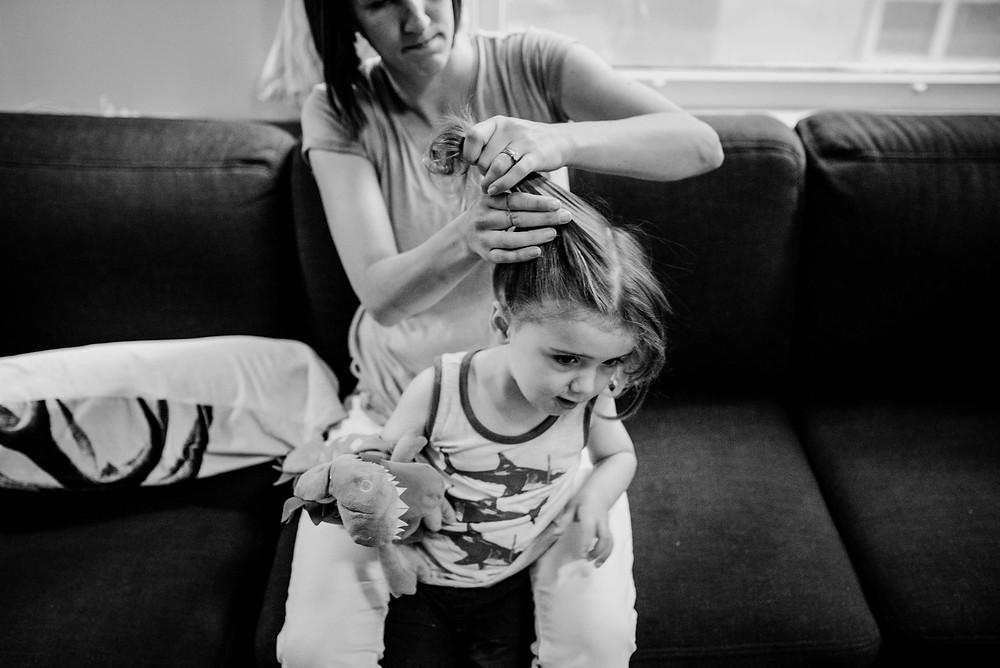 mom doing kids hair