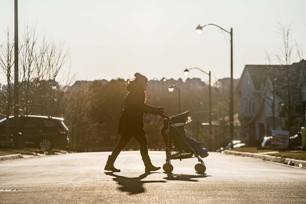 mom pushing stroller