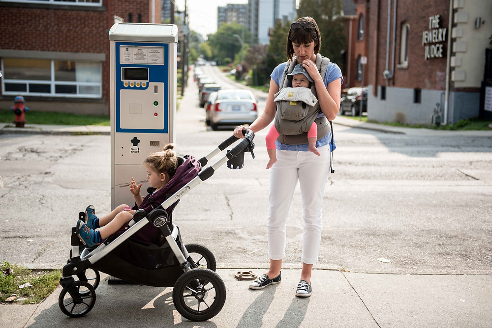 mom with child in stroller and baby carrier