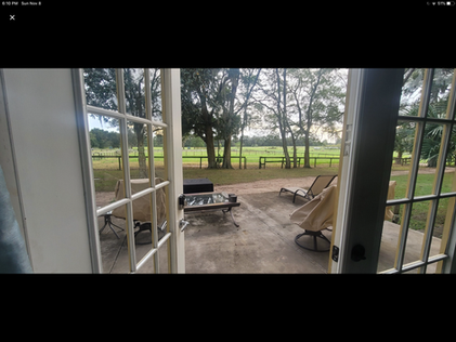 with large deck overlooking the horses