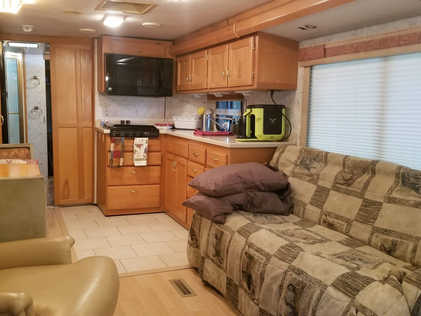 with spacious living area, full kitchen, and 55 inch TV