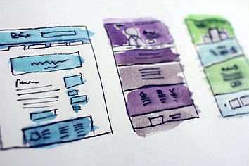 Pen and watercolour images of website page designs