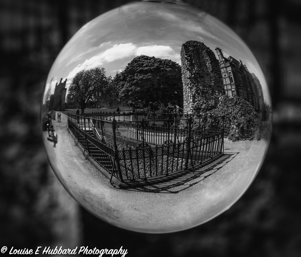 Fenced Stairs reflected in a lens ball