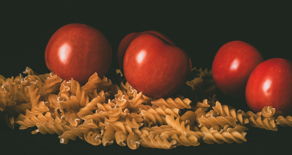 Photograph of tomatoes and Pasta shot in low key lighting