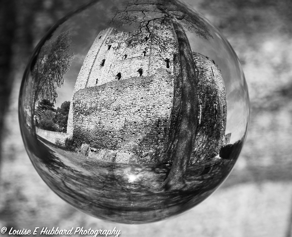 Rochester Castle reflected in a lens ball