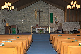 Interior of St. Mary Catholic Church from back of church facing the altar.