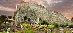 Panorama of the Shrine of Our Lady of the Woods in full bloom with colorful sky.
