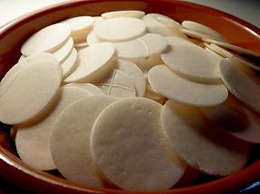 Closeup of bowl full of hosts.