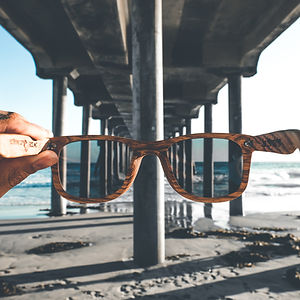 Wooden shades with the finest polarized lenses on the beach.
