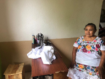 Mayan Embroider by her sewing machine