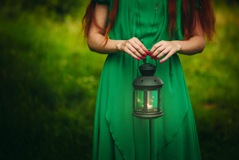 bigstock-Woman-Holding-Lantern-With-Can-