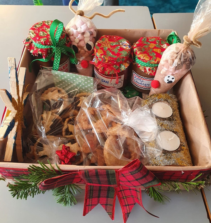 Children create Christmas hampers filled with gifts
