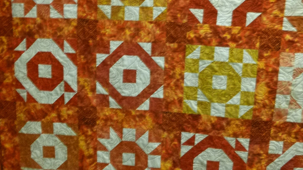 Batik Throw Qullt in reds, oranges, and golds