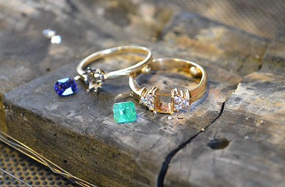 Removing the emerald and sapphire from their settings for the jewellery remodel at HR Jewellery Designs Hampshire / Southampton