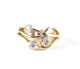 Diamond and yellow gold flowing wave ring