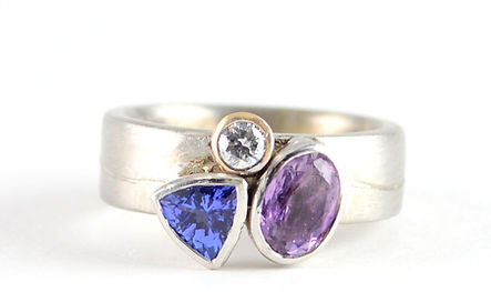 Trilogy ring using Tanzanite, Amethyst and Diamond designed by HR Jewellery Designs, Hampshire