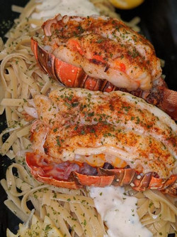 Lobster tails over bed of fettuccine