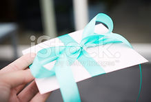 stock-photo-44943850-beautfully-wrapped-gift-enevelope.jpg
