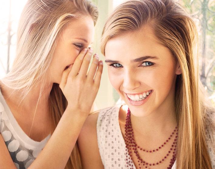 Girls whispering about OrthoAlign
