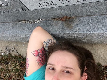 Lying on our Grave