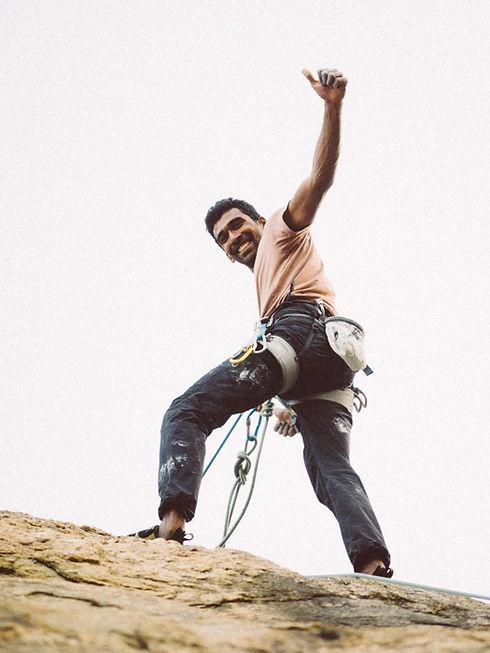Rock Climbing instructor Yash Choudhari, using rock climbing equipement for sport climbing.