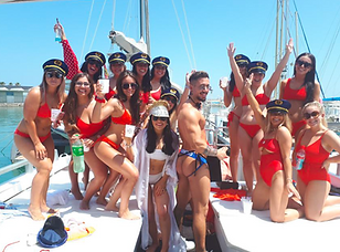 "Cheeky butler and girls on a hen party on board in the ""Sea Experience"" boat for parties"