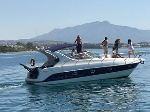 Maremagnum yacht for hen do navigating with group of girls enjoying the boat party