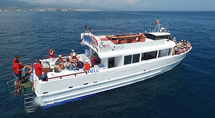 "The ""Sea Experience"" boat for hen do on the sea from the air with a large group of girls on board"