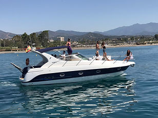 Maremagnum yacht for hen parties on the sea with girls on the deck