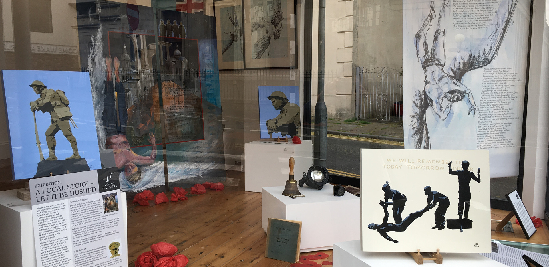 Window display of the Local Story - Let it be Hushed exhibition
