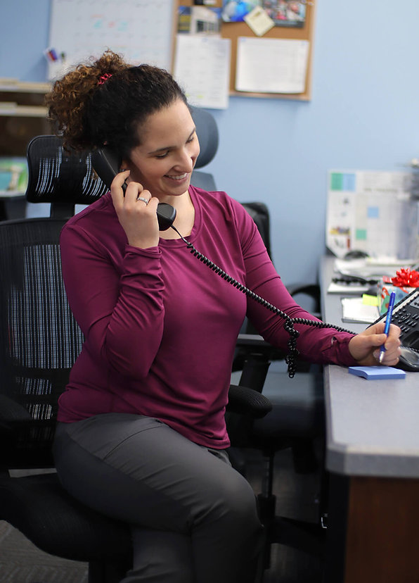 Yorkton's Athletic Physiotherapist Jannalee Edgar helping her clients over the phone