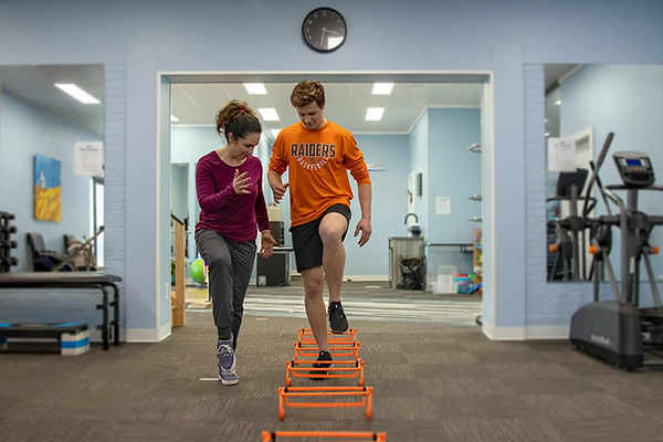 Yorkton Athletic physiotherapy Jannalee Edgar working with football athletes