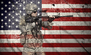 soldier holding rifle on a usa flag back