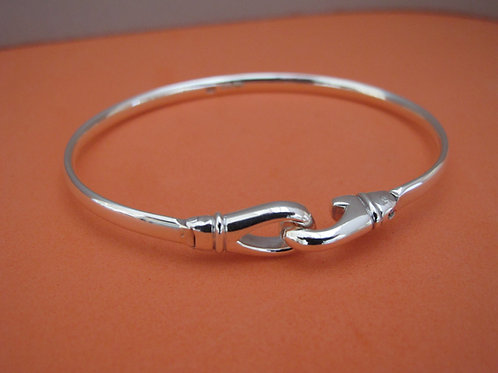 A Hook and clip, solid silver bangle.
