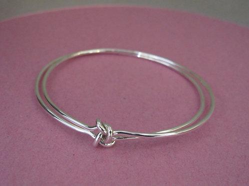 Two strand bangle with interlocking knot