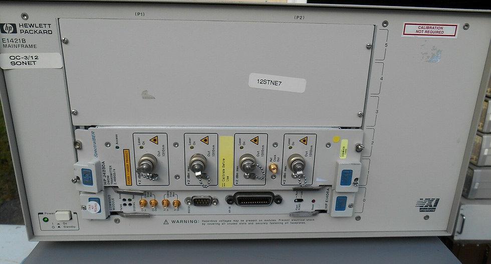 Agilent VXI mainframe E1421B w J4230A / E1406A
