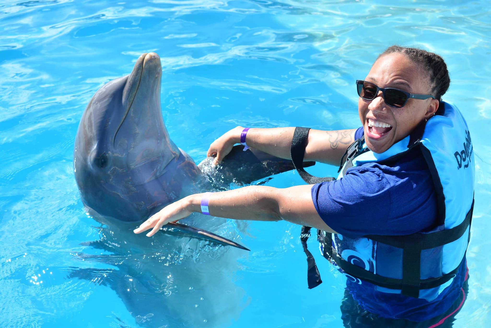 Nickole swimming with the dolphins!