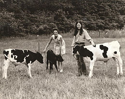 Dolores Hassick and daughter with calves