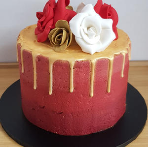 Red gold drip cake