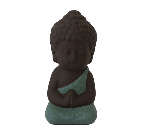 Pequeño Buda verde mar