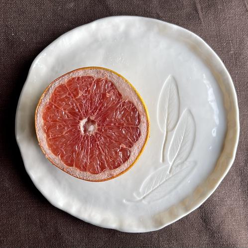 Porcelain plate with sage leaf decoration