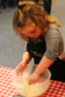A child cooking at an Explorers Cooking Birthday Party
