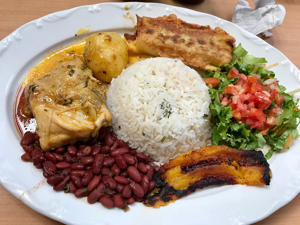 Rice, beans, chicken, plantain, salad, potato, tamale