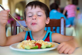 child eating -restaurant menu.jpg