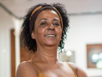 Mulher, negra e premiada pelo trabalho no serviço público